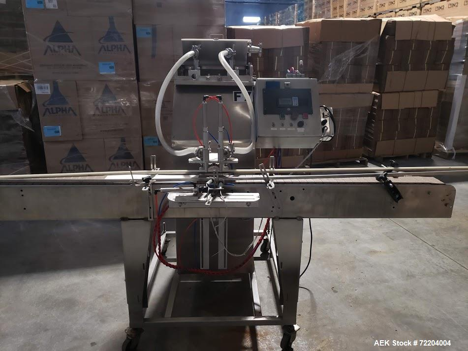Used- Keith Machinery Co Inline Piston Filler, Model RJM. Filler has 2-up positive shut-off design with pneumatic indexing. ...
