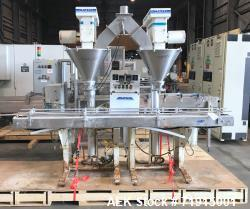 "Used-Mateer Burt Model 4009 dual head automatic inline auger/powder filler.  Container size: up to 7"" in Width. Has Digicoun..."