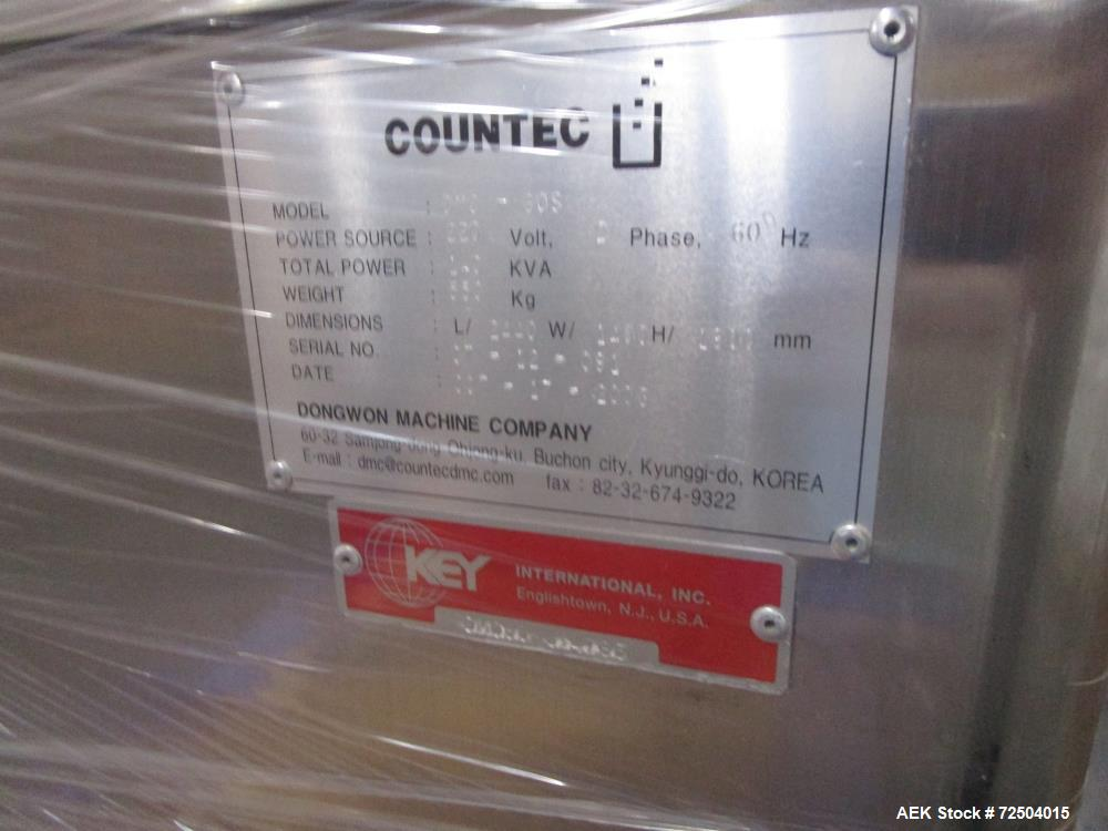 Used-Countec Model DMS-60S electronic channel tablet counter. Capable of speeds up to 6,000 tablets per minute. Tablet size ...