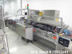 Used-Used Uhlmann thermoforming blister packaging machine, model UPS 4, Unit includes roll feed assembly, Neslab Chiller, fo...