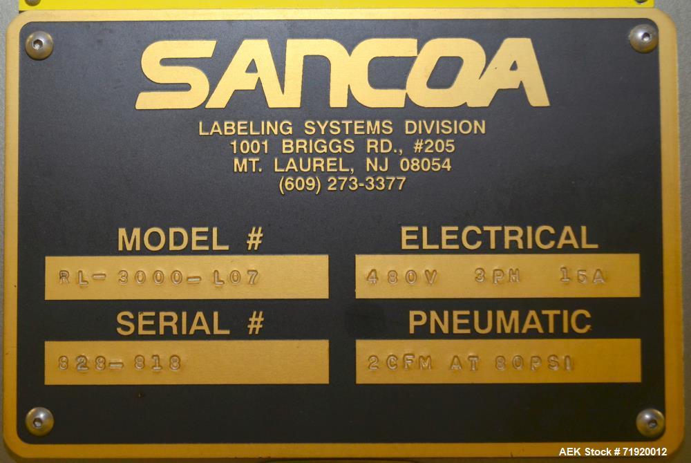 Used- Sancoa 3-head, 7-station pressure sensitive rotary labeler