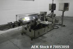 Used New Jersey wrap around labeler, model 334RSTP, speeds up to 400 units/minute, trunion roll bott...