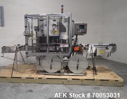 """Used PDC neck bander sleever, model 75E, speeds up to 300 containers/minute, .375 - 3.5"""" diameter, ...."""
