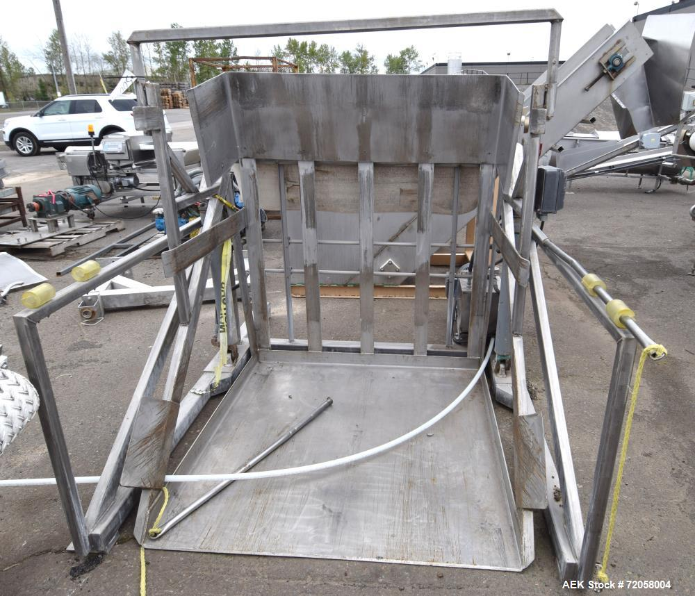 "Used- Hydraulic Tote Dumper. Stainless steel frame, dual ram, approximate tote size 50"" wide x 50"" long x 64"" tall. Includes..."