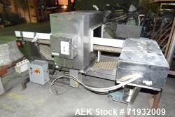 "Used- Goring Kerr Tek-21 Metal Detector. Approximate 24"" wide x 10.5"" tall aperture opening. Mounted on a 20"" wide x 96"" lon..."