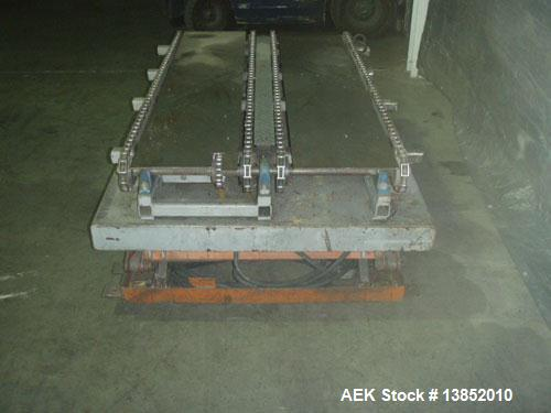 Used-Olympic Material Handling pallet conveyor with hydraulic lift. Drag chain pallet conveyor with hydraulic scissor lift. ...