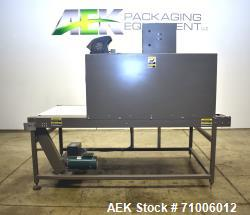 """Used-Arpac Model HVP4/488 automatic large chamber shrink tunnel. Has a 37""""w x 96""""l belt conveyor. Chamber size: 43""""w x 20""""H ..."""