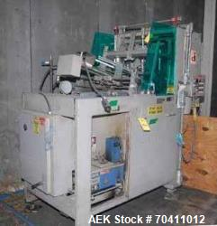 Used- Delkor, Model 751 Paperboard (single ply)  Tray Erector. Includes Nordson hot melt glue system.