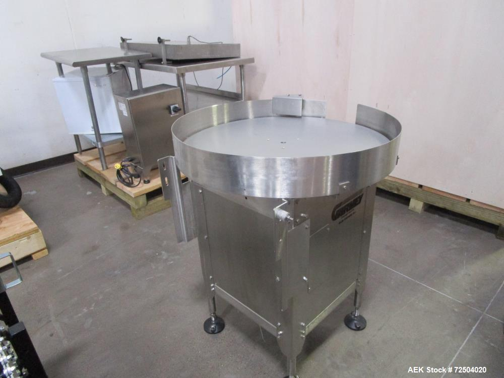 "Used-Garvery 36"" Diam stainless steel accumulation table."