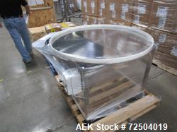 """Approximately 42"""" Diam stainless steel accumulation table."""