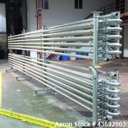 Used- Feldmeier Shell and Tube Heat Exchanger/Pasteurizer Rack, Model 252 DT. 720 feet of tubing. 304/316 stainless steel pr...