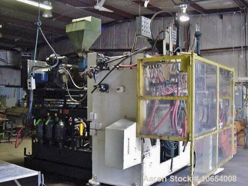 Used-Fischer Blow Molding Machine, Model FHB-106-2.  Dual shuttle, many heads to choose from.  Maco 100 point Parison progra...