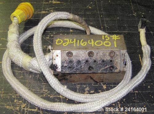 """Used- 6 Hole Strand Die, Carbon Steel. Approximate 1/2"""" diameter back center feed."""