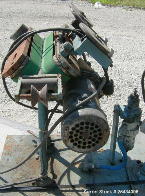 """Used-  Puller, """"V"""" Shaped.  (2)  1 3/4"""" wide x 12"""" long belts.  Manually adjustable height. Driven by a  3/4 hp, 90 volt, 25..."""
