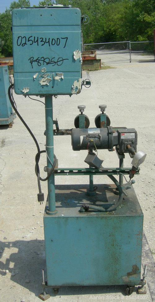 """Used-  Puller, 2"""" wide x 12"""" long bottom belt.  (2) 4"""" diameter x 2"""" wide top rubber rolls.  Manually adjustable.  Driven by..."""