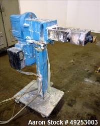 Used- Coperion Werner & Pfleiderer twin screw side feeder model ZS-B 58, driven by a 5.5 KW motor. Approximate screw shaft s...