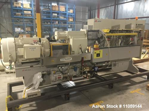 Used- APV Baker Perkins Model MP80 Twin Screw Extruder. 80 mm Screws. Typical outputs 1500-2900 (kg/h). Driven by a Reliance...