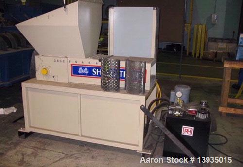"Used-Shred-Tech Model STS-7 Single Shaft Shredder. 12.5"" x 24"" hopper opening, ram feed, 10 hp, approximately 10 hours of us..."