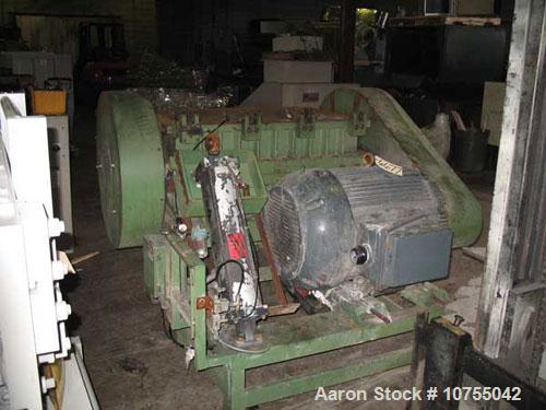 "Used-Rapid Model 2442H Granulator. 24"" x 42"" cutting chamber dimension. Conveyor infeed with pneumatic tilt back assist. Uni..."