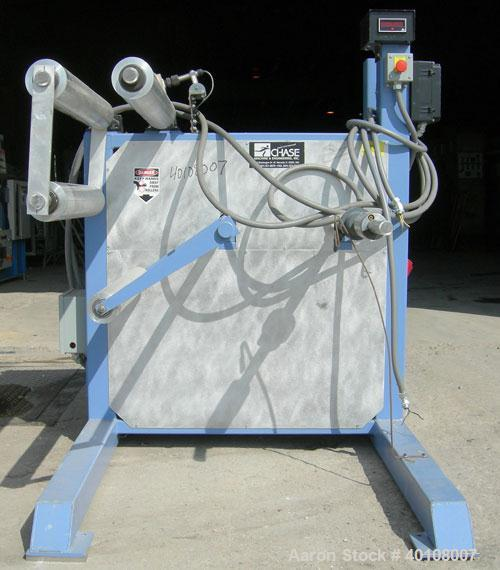 """Used:Chase Machine and Engineering rewind unit. Single station. Approximately 30"""" wide capacity. Driven by a 3/4hp,180 volt,..."""