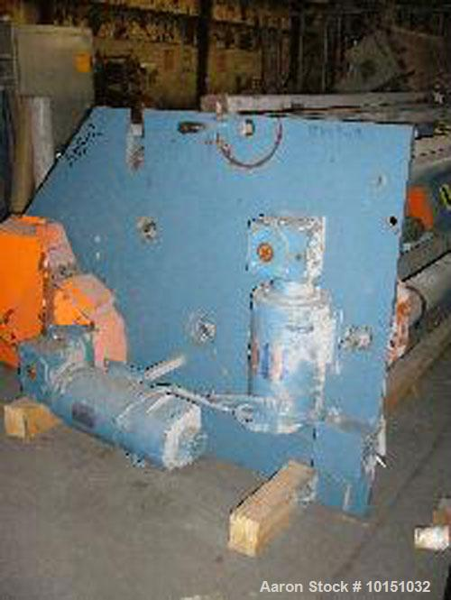 "Used-72"" Wide APV Single Turret Winder. Will accommodate 24"" diameter roll, has flying knife cut off hydraulically actuated ..."