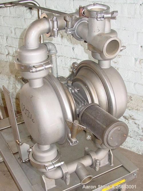 """Used- Diaphragm Pump, Air Operataed, stainless steel. 2"""" tri-clamp inlet/outlet. Mounted on a stainless steel cart with cast..."""