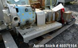 Used- Waukesha Positive Displacement Pump, Model 015, Stainless Steel. Approximate displacement 0.142 gallons per revolution...