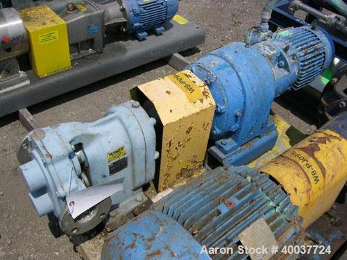 "Used- Waukesha Rotary Lobe Pump, Model 55I, stainless steel construction, 2"" inlet/outlet, rated up to 60 GPM, on base with ..."