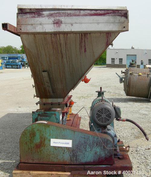 "Used- Moyno pump, model 2JOJS3 SSQ, trim AEA-NK. Open throat design with lump breaker, and feed screw. 8"" discharge. 316 sta..."