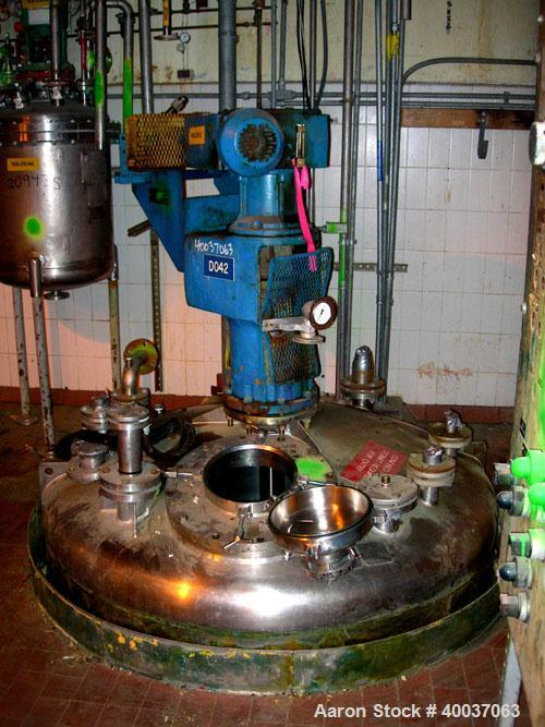 """Used: Walker Stainless reactor, 1500 gallon, stainless steel, vertical. Approximately 66"""" diameter x 96"""" straight side, dish..."""