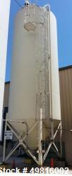"PlasticStor model 1220 silo, 10 deg top, 45 deg cone, includes side ladder. The silo is estimated at 12 diameter by 331"" hei..."