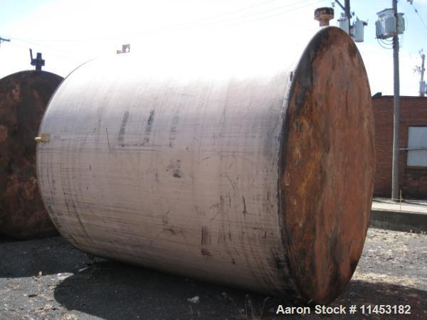 """Used-7500 Gallon Vertical Tank, carbon steel construction, 10.5' diameter x 12' high, with 20"""" side manway, 4"""" drain on side..."""