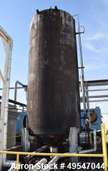 """Used- Tank, Approximate 6800 Gallon, Carbon Steel, Vertical. Approximate 96"""" diameter x 216"""" straight side, coned top and bo..."""