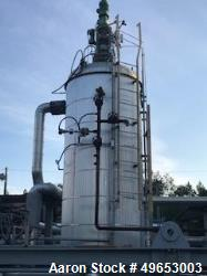 Used-  CMC Letco Industries Storage Pressure Vessel with Internal Helic Pipe Coil. Gallon, carbon steel shell. Vertical. Car...