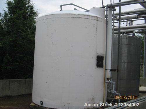 "Used-Tank, 6000 Gallon, Plastic, Vertical.  114"" Diameter x 126"" straight side, dish top, flat bottom.  Openings:  top manwa..."