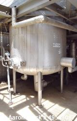 """Used- Tank, 1200 Gallon, Stainless Steel, Vertical. 72"""" Diameter x 60"""" straight side, dished top and bottom. Mounted on 4 st..."""
