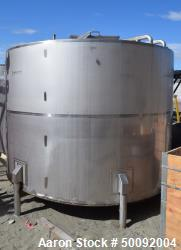 Used-Item I-3500 Gallon stainless steel mix tank, flat top, manway, 5 HP. sweep agitator, valves, piping