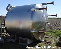 "Used- Tank, 2400 Gallon, Stainless Steel, Vertical. Approximate 94"" diameter x 88"" straight side. Flat top with (2) 1/3 hing..."