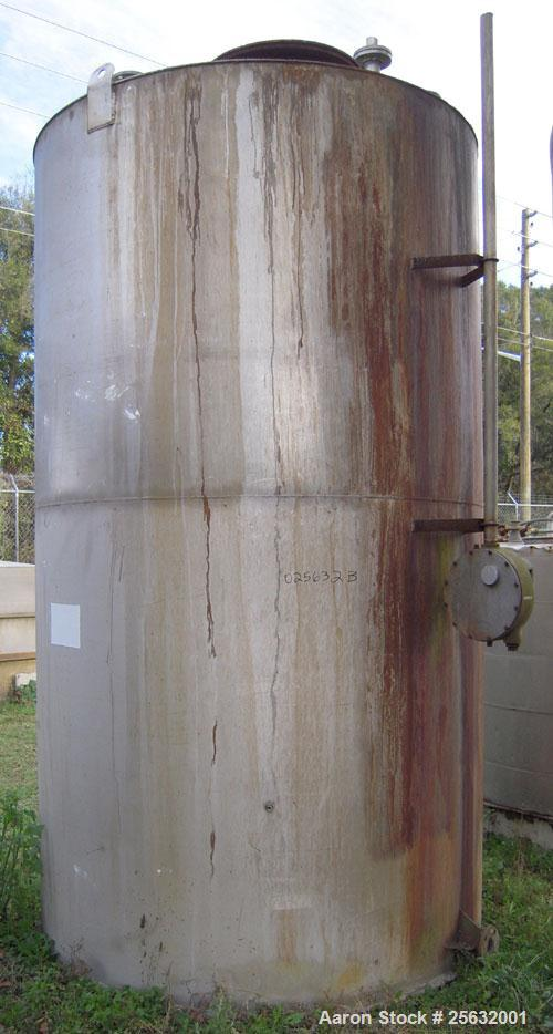 """Used- Tank, 2800 Gallons, Stainless Steel, Vertical. Approximately 78"""" diameter x 132"""" straight side. Flat top, sloped botto..."""