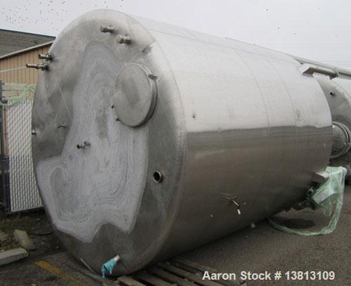 Used-Sani Tank Stainless Steel Mixing Tank, 4,000 Gallons.  Side agitated, stainless steel, side and top manways.  Slope bot...