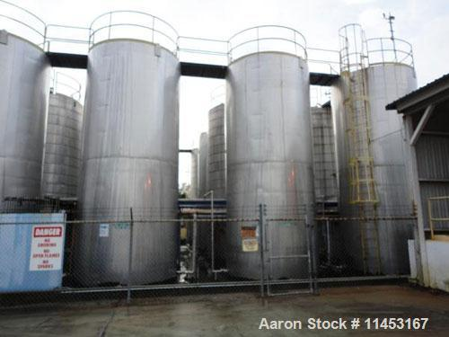 """Used-15,000 Gallon Stainless Steel Tank, approximately 10'6"""" diameter x 23' straight side, slight cone top, flat bottom."""