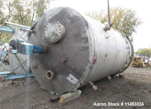 Used- 12,000 Gallon Process Industries Mix Tank. 304 stainless steel construction. Approximately 12' diameter x 16' straight...