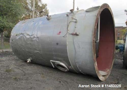 """Used- 12,000 Gallon Stainless Steel Tank. 12' diameter x 16' straight side. 4' carbon steel skirt; dished ends. 24"""" side bot..."""