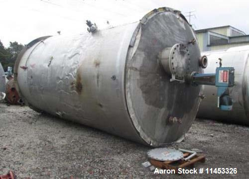 """Used- 12,000 Gallon 304 Stainless Steel Tank. 12' diameter x 16' straight side. 4' carbon steel skirt, dished ends, 24"""" side..."""