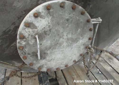"""Used- 12,000 Gallon Stainless Steel Tank. 12' diameter x 16' straight side. 4' carbon steel skirt, dished ends, 24"""" side bot..."""