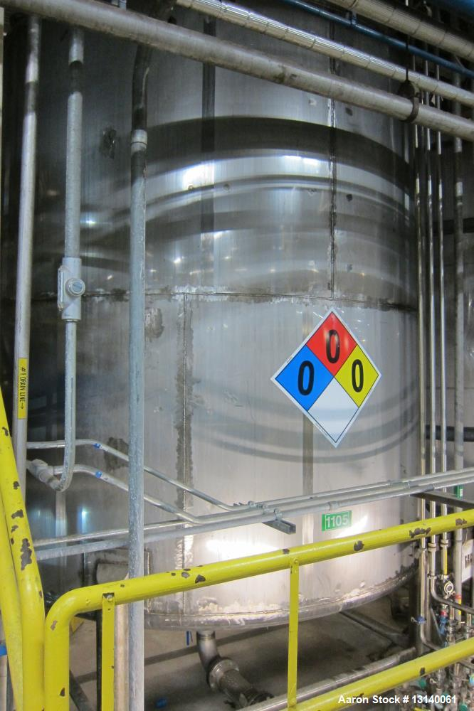 """Used approximately 10,500 gallon 316L stainless steel vertical storage tank. 12 diameter X 124"""" high straight side. Welded d..."""