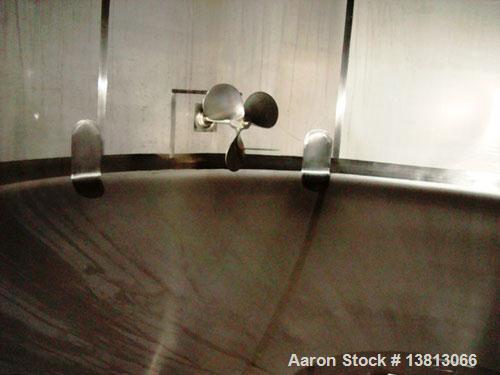 "Used-7,500 Gallon Stainless Steel Mix Tank. 10' diameter x 11'6"" straight side. 15'6"" overall height. 8 mild steel legs. Sid..."