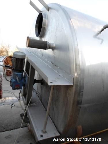 Used- 5000 Gallon Jacketed SFI Stainless Steel Storage Tank. 10' diameter, 11 1/2' straight wall. Top agitated with 5 hp 3/6...