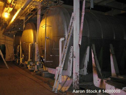 """Unused-USED: Tank, 50,330 gallon, 304 stainless steel. 13'3"""" diameter approximately 48' long. Horizontal on carbon steel cra..."""
