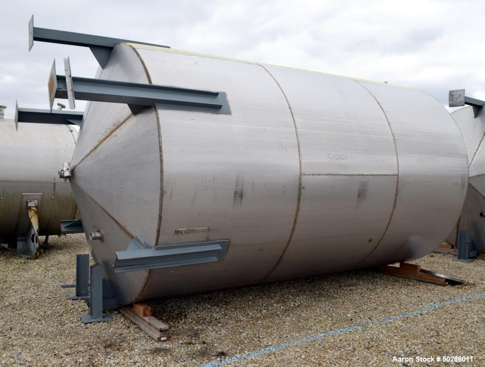 "Used- Tank, 8,000 Gallon, Stainless Steel, Vertical. Approximate 112"" diameter x 180"" straight side, flat top, coned bottom...."